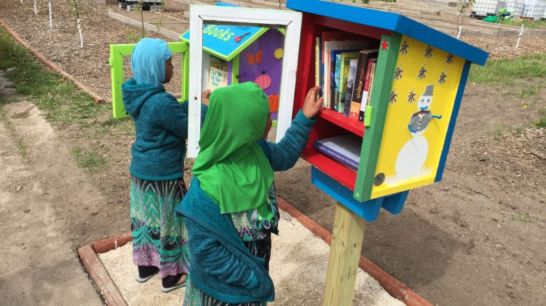 Picture of children picking out books at Cherry Street Garden's Little Free Libraries